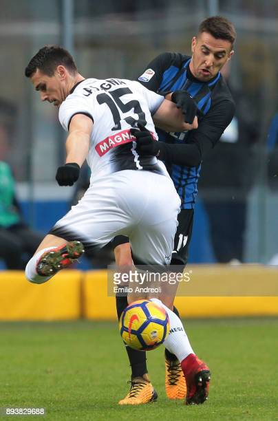 Matias Vecino of FC Internazionale Milano competes for the ball with Kevin Lasagna of Udinese Calcio during the Serie A match between FC...