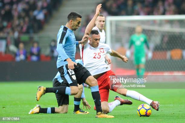 Matias Vecino of Uruguay and Jaroslaw Jach of Poland during the international friendly match between Poland and Uruguay at National Stadium on...