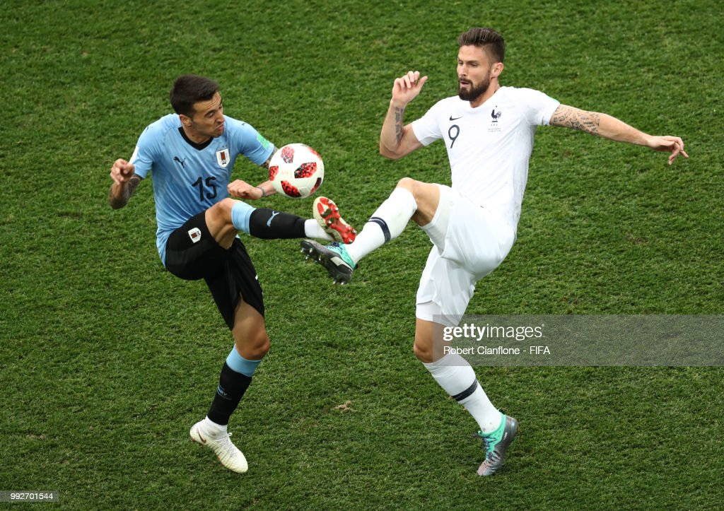 Matias Vecino of Uruguay and Olivier Giroud of France battle for the ball during the 2018 FIFA World Cup Russia Quarter Final match between Uruguay and France at Nizhny Novgorod Stadium on July 6, 2018 in Nizhny Novgorod, Russia.