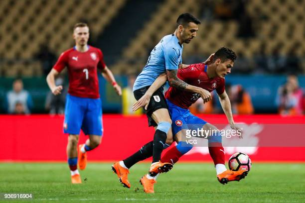 Matias Vecino of Uruguay and Patrik Schick of Czech Republic compete for the ball during the 2018 China Cup International Football Championship match...