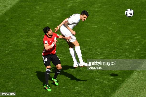 Matias Vecino of Uruguay challenge for the ball with Ali Gabr of Egypt during the 2018 FIFA World Cup Russia group A match between Egypt and Uruguay...