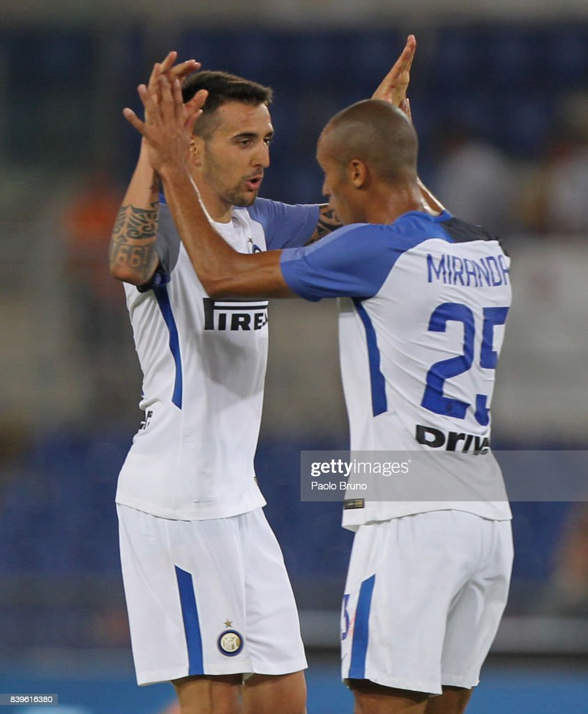 Matias Vecino with his teammate Miranda of Internazionale celebrates after scoring the team's third goal during the Serie A match between AS Roma and FC Internazionale on August 26, 2017 in Rome, Italy.