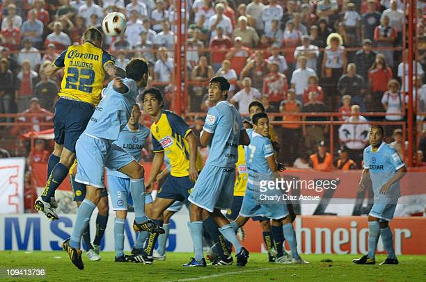 Matias Vuoso of America jump for the ball during a match against Argentinos Junior as part of the Santander Libertadores Cup 2011 at Diego Armando...