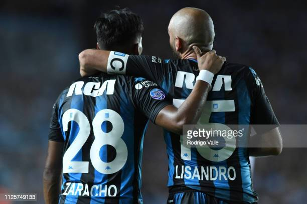 Matias Zaracho of Racing Club celebrates with teammate Lisandro Lopez after scoring the third goal of his team during a match between Racing Club and...