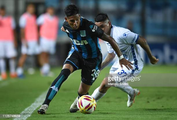 Matias Zaracho of Racing Club fights for the ball with Facundo Barboza of Godoy Cruz during a match between Racing Club and Godoy Cruz at Juan...