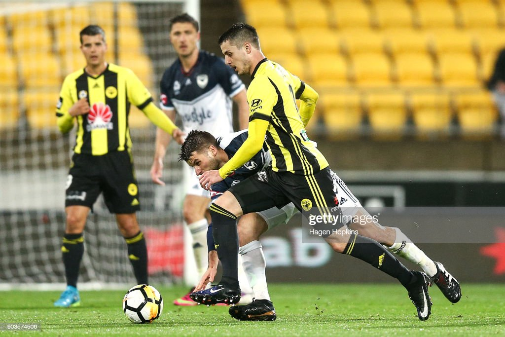 Matija Ljujic of the Phoenix beats the challenge of Terry Antonis of the Victory during the round 15 A-League match between the Wellington Phoenix and Melbourne Victory at Westpac Stadium on January 10, 2018 in Wellington, New Zealand.