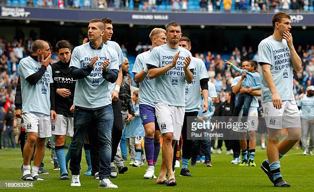 Matija Nastasic and Aleksander Kolarov of Manchester City clap towards the home fans at full time of the Barclays Premier League match between...