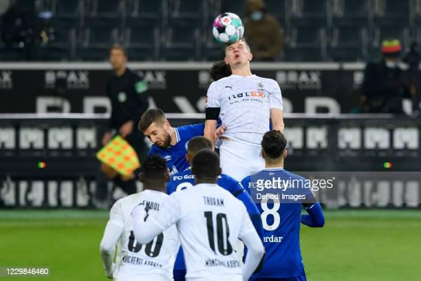 Matija Nastasic of FC Schalke 04 and Matthias Ginter of Borussia Moenchengladbach battle for the ball during the Bundesliga match between Borussia...