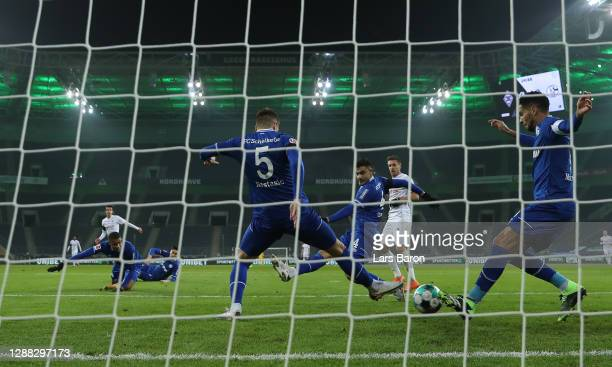 Matija Nastasic of FC Schalke 04, and Omar Mascarell of FC Schalke 04 attempt to clear the ball as Florian Neuhaus of Borussia Monchengladbach scores...