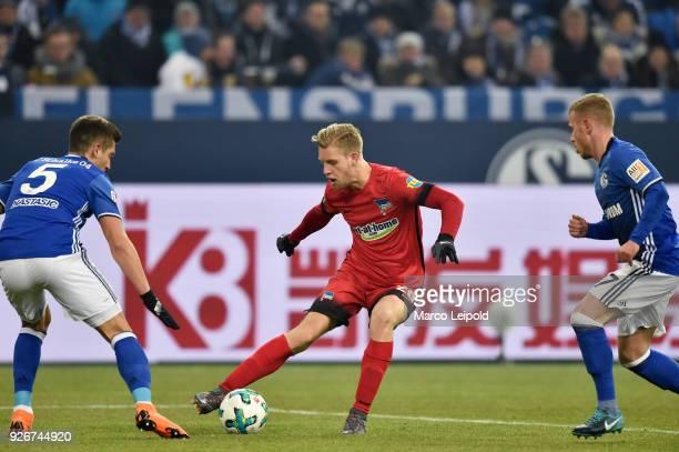Matija Nastasic of FC Schalke 04 Arne Maier of Hertha BSC and Max Meyer of FC Schalke 04 during the first Bundesliga match between Schalke 04 against...
