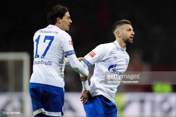 Matija Nastasic of FC Schalke 04 celebrates with his team mate after Benjamin Stambouli scoring his team's first goal during the Bundesliga match...