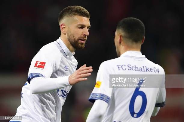 Matija Nastasic of FC Schalke 04 celebrates with his team mate after Omar Mascarell scoring his team's first goal during the Bundesliga match between...