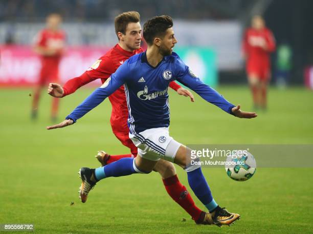 Matija Nastasic of Schalke 04 battles for the ball with Lukas Klunter of FC Koeln during the DFB Pokal match between FC Schalke 04 and 1 FC Koeln at...
