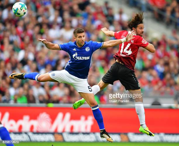 Matija Nastasic of Schalke 04 challenges Martin Harnik of Hannover 96 during the Bundesliga match between Hannover 96 and FC Schalke 04 at HDIArena...