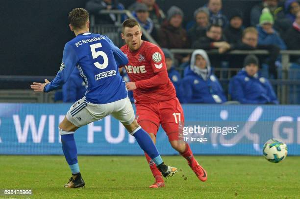 Matija Nastasic of Schalke and Christian Clemens of Koeln battle for the ball during the Bundesliga match between FC Schalke 04 and 1 FC Koeln at...