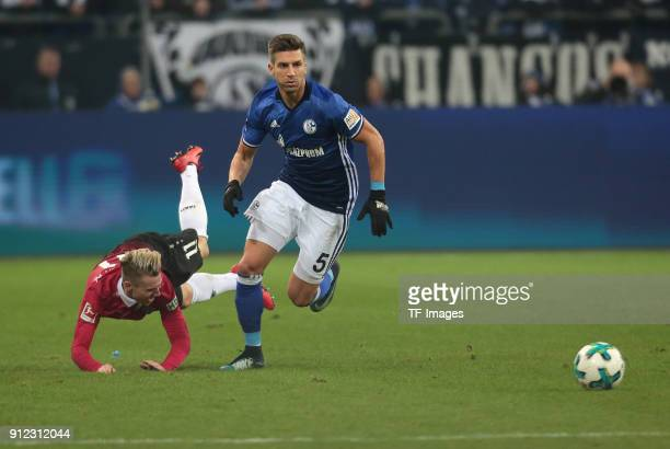 Matija Nastasic of Schalke and Felix Klaus of Hannover battle for the ball during the Bundesliga match between FC Schalke 04 and Hannover 96 at...