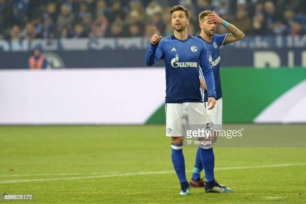 Matija Nastasic of Schalke and Guido Burgstaller of Schalke looks on during the Bundesliga match between FC Schalke 04 and 1 FC Koeln Bundesliga at...