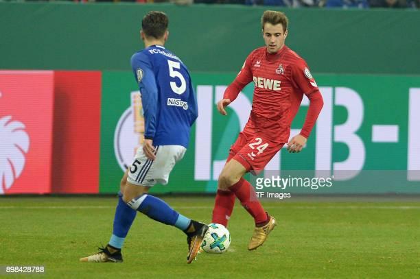 Matija Nastasic of Schalke and Lukas Kluenter of Koeln battle for the ball during the Bundesliga match between FC Schalke 04 and 1 FC Koeln at...