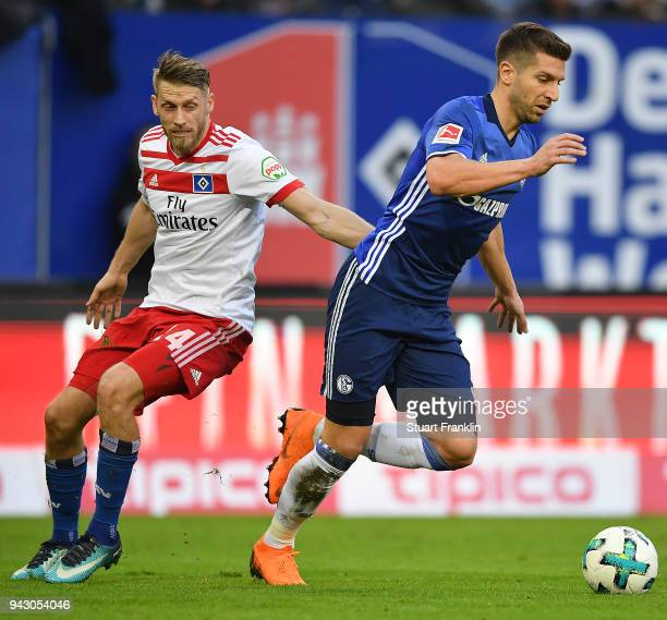 Matija Nastasic of Schalke fights for the ball with Aaron Hunt of Hamburg during the Bundesliga match between Hamburger SV and FC Schalke 04 at...