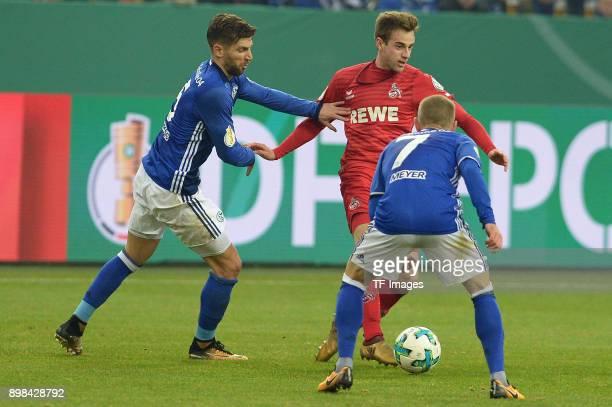 Matija Nastasic of Schalke Lukas Kluenter of Koeln and Max Meyer of Schalke battle for the ball during the Bundesliga match between FC Schalke 04 and...