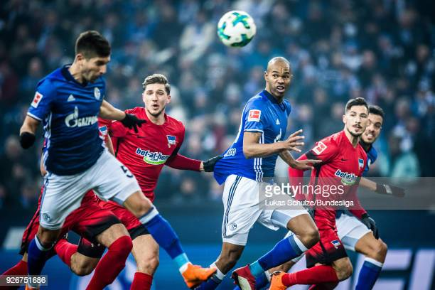 Matija Nastasic of Schalke Niklas Stark of Berlin Naldo of Schalke and Mathew Leckie look after the ball during the Bundesliga match between FC...
