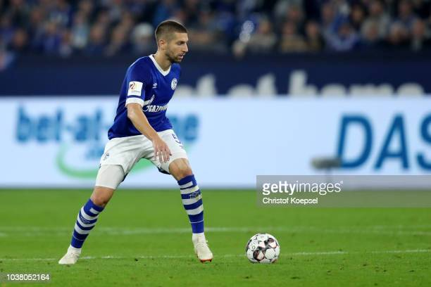 Matija Nastasic of Schalke runs with the ball during the Bundesliga match between FC Schalke 04 and FC Bayern Muenchen at VeltinsArena on September...