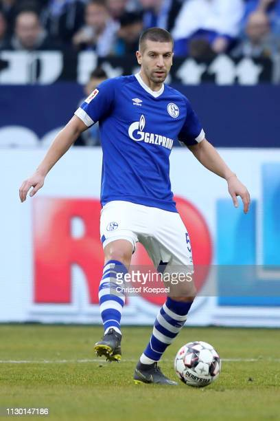 Matija Nastasic of Schalke runs with the ball during the Bundesliga match between FC Schalke 04 and SportClub Freiburg at VeltinsArena on February 16...