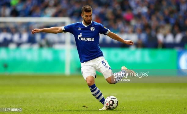 Matija Nastasic of Schalke runs with the ball during the Bundesliga match between FC Schalke 04 and FC Augsburg at VeltinsArena on May 05 2019 in...