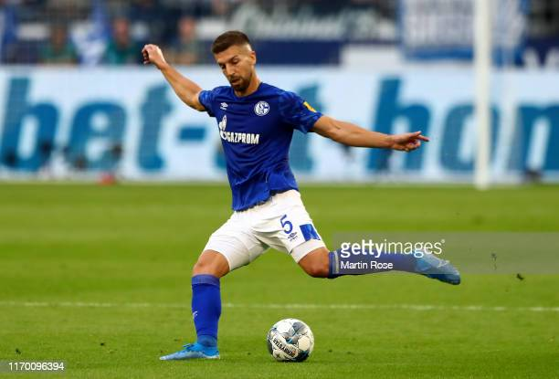 Matija Nastasic of Schalke runs with the ball during the Bundesliga match between FC Schalke 04 and FC Bayern Muenchen at VeltinsArena on August 24...