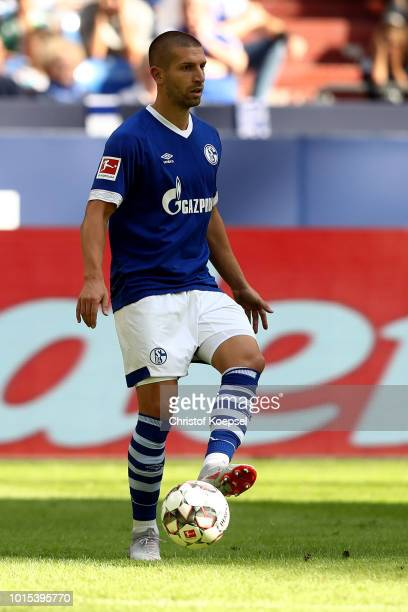 Matija Nastasic of Schalke runs with the ball during the friendly match between FC Schalke 04 v AFC Fiorentina at Veltins Arena on August 11 2018 in...