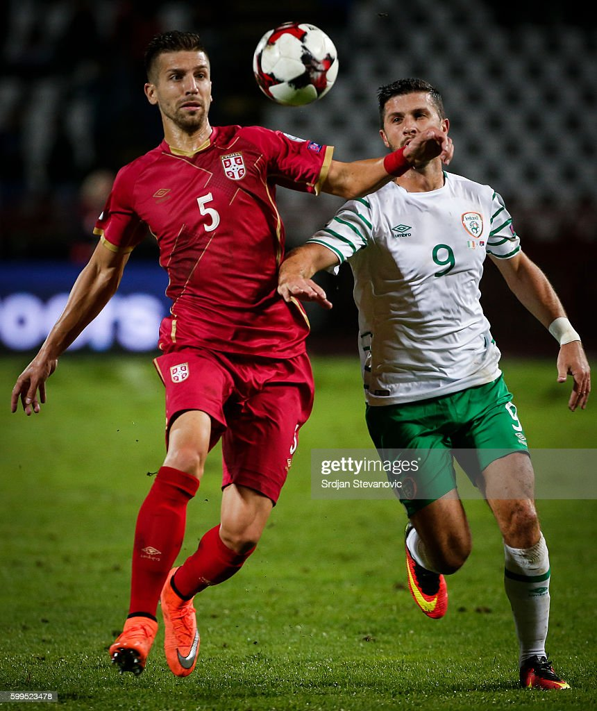 Matija Nastasic (L) of Serbia competes for the ball against Shane Long (R) of Ireland during the FIFA 2018 World Cup Qualifier between Serbia and Ireland at stadium Rajko Mitic on September 5, 2016 in Belgrade.