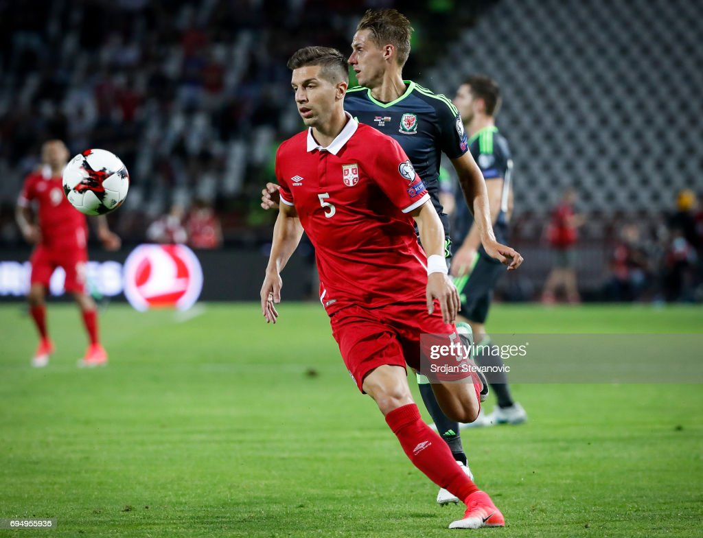 Matija Nastasic (L) of Serbia in action during the FIFA 2018 World Cup Qualifier between Serbia and Wales at stadium Rajko Mitic on June 11, 2017 in Belgrade, Serbia.