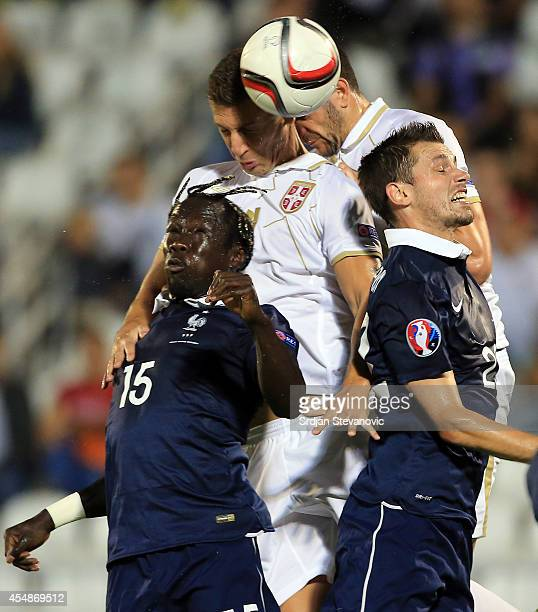 Matija Nastasic of Serbia jump for the ball against Bacary Sagna of France during the International friendly match between Serbia and France at the...