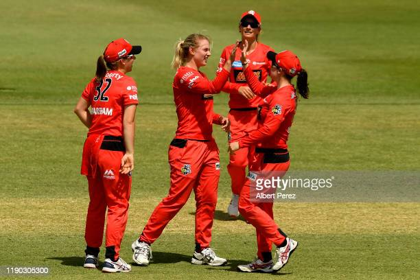 Matilan Brown of the Renegades celebrates with team mates after bowling out Maddy Green of the Heat during Women's Big Bash League match between the...