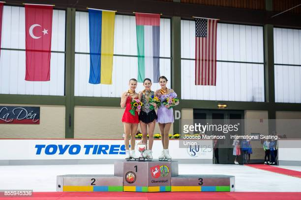 Matilda Algotsson of Sweden Kailani Craine of Australia and Alexia Paganini of Switzerland pose in the Ladies medal ceremony during the Nebelhorn...