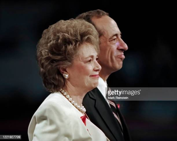 Matilda Cuomo wife of New York Governor Mario Cuomo stands with her husband on the centre stage during the Democratic National Nominating Convention...