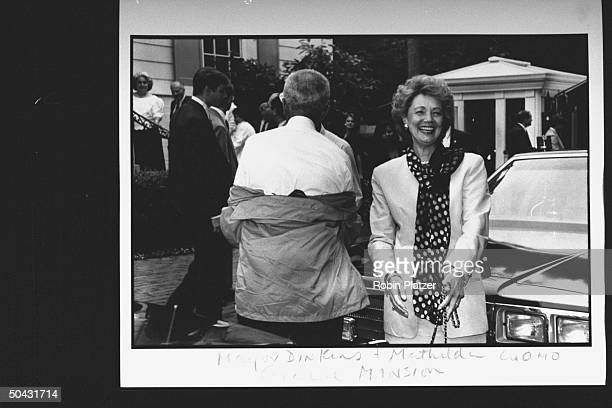 Matilda Cuomo, wife of NY Gov. Mario Cuomo, arriving at the Reebok party for Dem. Supporters, w. NYC Mayor David Dinkins standing nearby, during the...