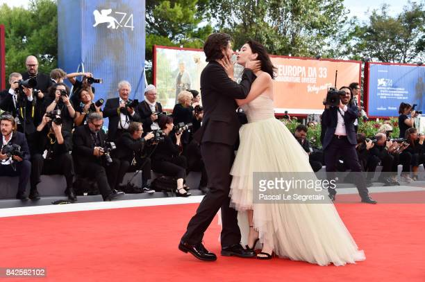 Matilda De Angelis and Andrea Arcangeli walk the red carpet ahead of the 'Una Famiglia' screening during the 74th Venice Film Festival at Sala Grande...