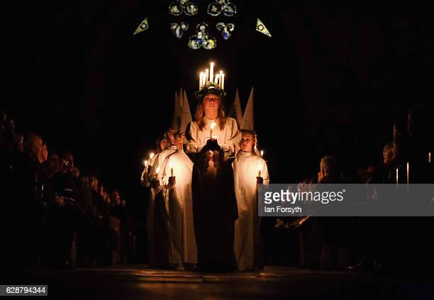 Matilda Jarl from the Jarfalla chamber choir near Stockholm Sweden plays the role of Lucia as she leads the procession during the Swedish Sankta...