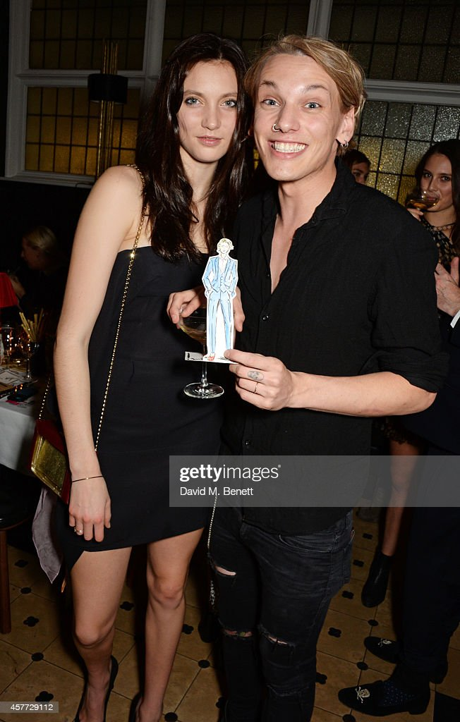 Matilda Lowther (L) and Jamie Campbell Bower attend the Charlotte Olympia 'Handbags for the Leading Lady' launch dinner at Toto's Restaurant on October 23, 2014 in London, England.