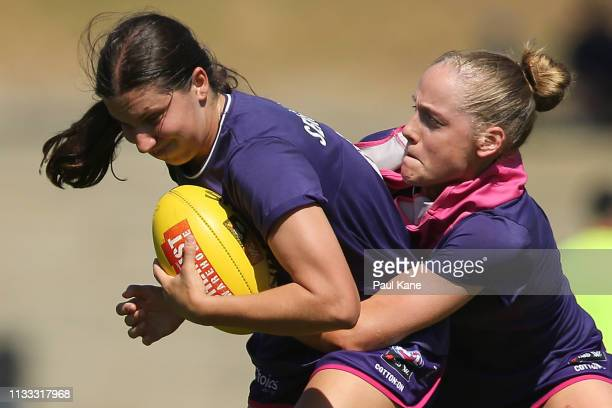 Matilda Sergeant and Stephanie Cain of the Dockers warm up during the round five AFLW match between the Fremantle Dockers and the Western Bulldogs at...