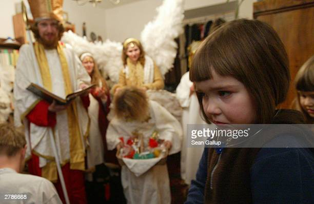 Matilda shows her fear of St Nicholas angels and devils who have come to visit her December 5 2003 in Prague Czech Republic Devils angels and St...