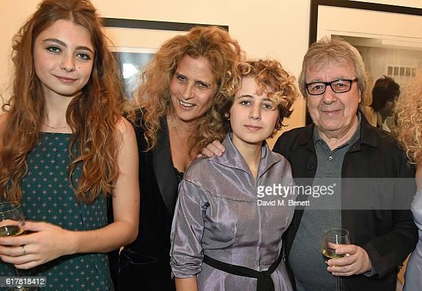 Matilda Wayman Suzanne Wayman Katherine Wyman and Bill Wyman attend a private view of Bill Wyman's photographic exhibition 'Around The World In 80...
