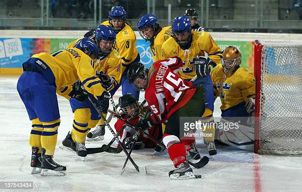 Matildah Andersson of Sweden battles with Julia Willenshofer of Austria in the Women's Final match between Sweden and Austria at the Tyrolean Ice...