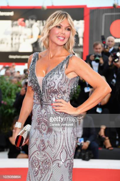 Matilde Brandi walks the red carpet ahead of the opening ceremony and the 'First Man' screening during the 75th Venice Film Festival at Sala Grande...