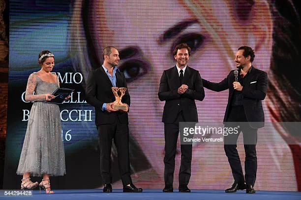 Matilde Gioli Alessandro Borghi receives Graziella Bonacchi Prize on stage from Claudio Santamaria and Stefano Accorsi during the Nastri D'Argento...