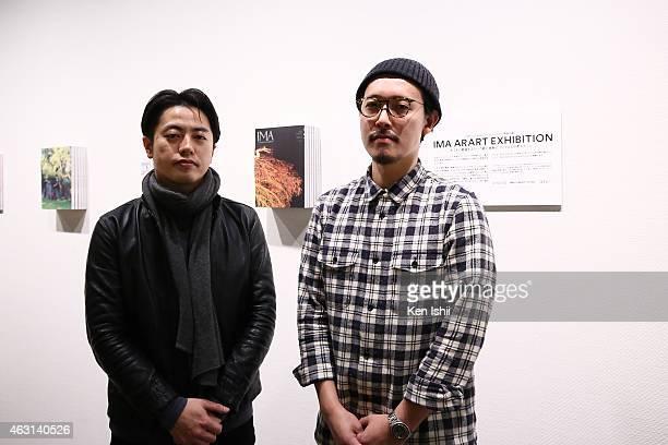 Matilde Inc representative Kei Shiratori and amana inc producer/manager Kazuhiro Hoshimoto pose for photo in front of their artwork 'IMA ARART...