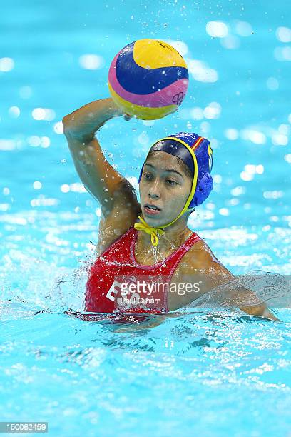 Matilde Ortiz Reyes of Spain passes the ball in the Women's Water Polo Gold Medal match between the United States and Spain on Day 13 of the London...