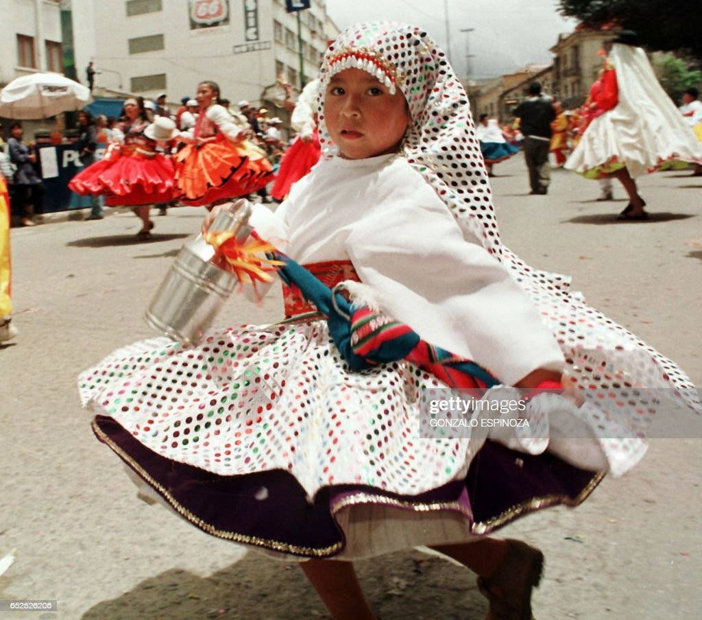 Matilde Pelaez, a young member of the local folk group 'Waka Tokoris', performs a traditional dance in the streets of La Paz, Bolivia, 23 February during the annual celebrations of the Andean Carnival