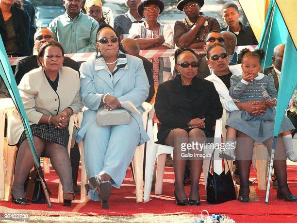 Matina Khoza sits beside her daughters Sonono Khoza and Zodwa Khoza as grand daughter Thando Motaung sits on the lap of a family friend September 24...
